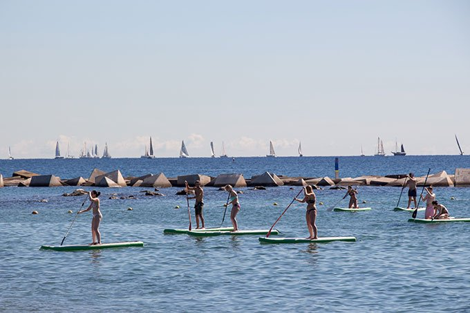 Standup paddle boarding at Barceloneta beach: Fun things to do in Barcelona for a girlfriends getaway.