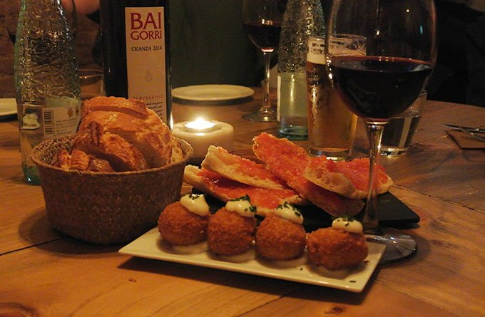 Eat tapas and drink wine: Fun things to do in Barcelona for a girlfriends getaway.