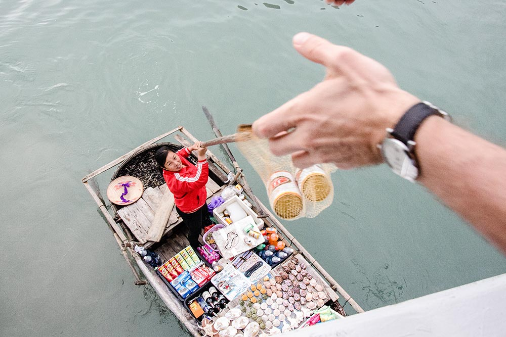 Woman selling beer from a boat