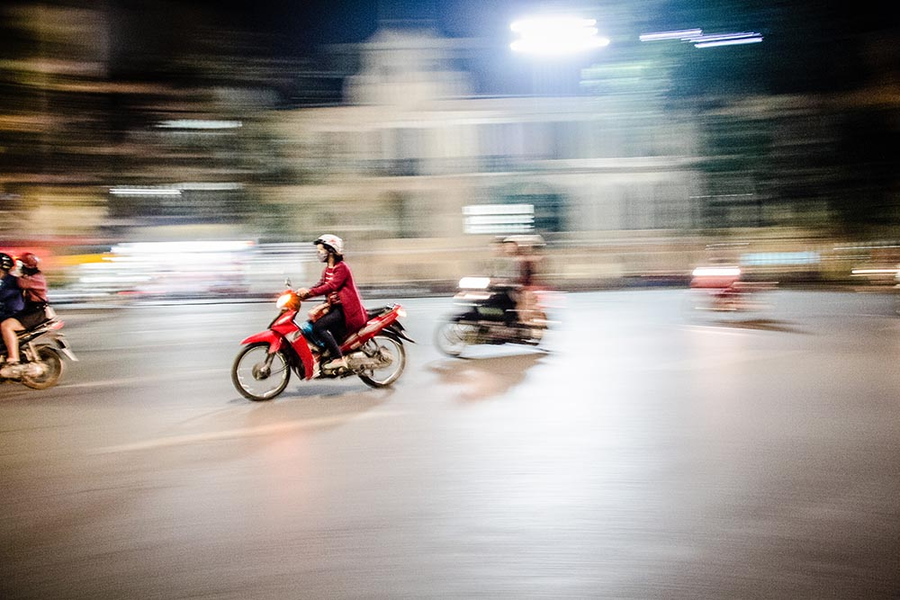 woman on red motorbike